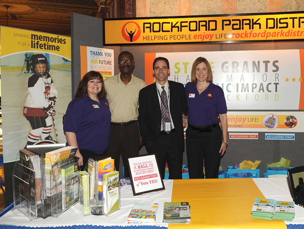 Visiting with Sen. Steve Stadelman are, from left, Laura Gibbs, public relations and new media manager for Rockford Park District; Nate Martin, vice president of the Illinois Association of Park Districts and formerly of RPD; and Denise Delanty, marketing manager for RPD.