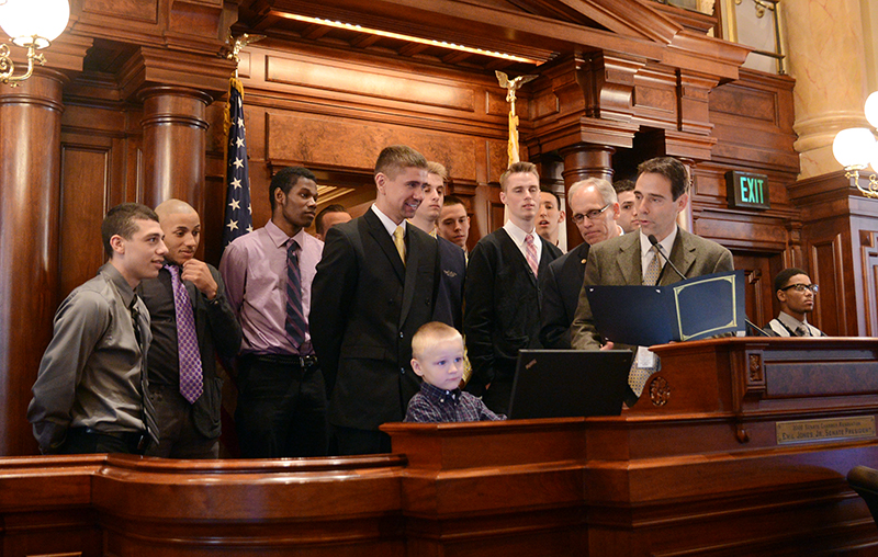Photo Caption: State Senator Steve Stadelman (D-Rockford) with Coach Craig Doty and the Rock Valley College men's basketball team.